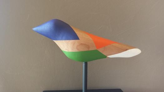 Multicolored, blue headed bird