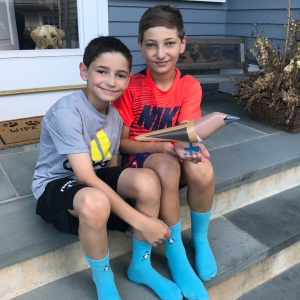 Matty and Will Gladstone, founders of the Blue Feet Foundation with my blue-footed booby made out of post-natural-disaster wood. Photo: Courtesy of Will Gladstone